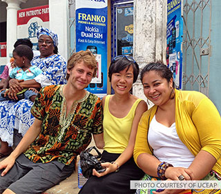 Three students studying abroad.