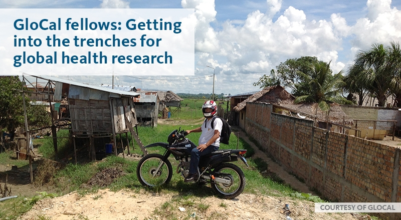 researcher on motorbike in the middle of an African farm